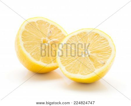 Two lemon halves isolated on white background one yellow lemon cut in half