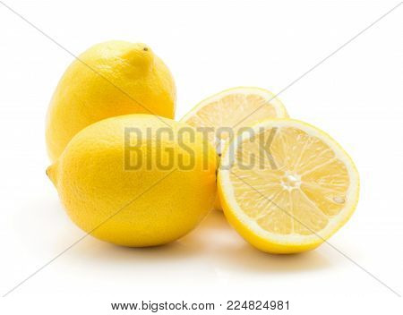 Lemons stack isolated on white background two whole and two sliced halves