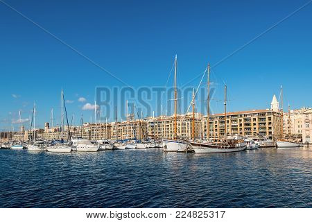 Marseille, France - December 4, 2016: Beautiful view with moored yachts and boats on a sunny day in Old Vieux Port of Marseille, Provence, France.