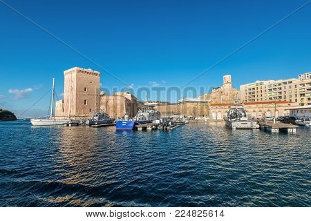 Marseille, France - December 4, 2016: Beautiful view with boats and Old Fortress - Saint Jean Castle on a sunny day in Old Vieux Port of Marseille, Provence, France.
