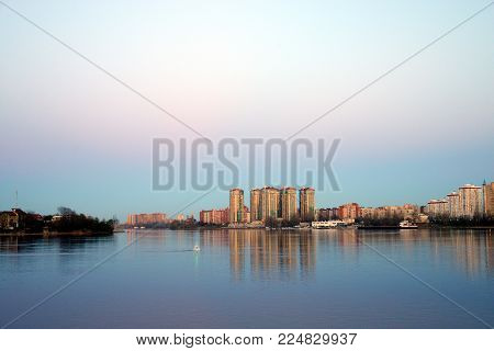 View of Neva river and microdistrict Ribatskoe on the outskirts of St. Petersburg at evening, Russia.