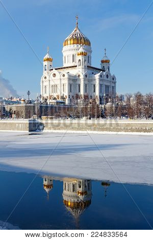 Moscow, Russia - February 01, 2018: Cathedral of Christ the Saviour with reflection in Moskva river on the blue sky background. Moscow in winter