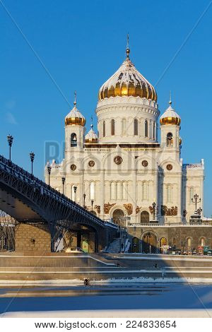 Moscow, Russia - February 01, 2018: Cathedral of Christ the Saviour on Patriarshiy Bridge background against the blue sky. Moscow in winter