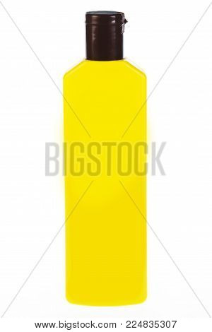 Yellow n tube bottle of shampoo, conditioner, hair rinse, gel, on a white background with reflection.