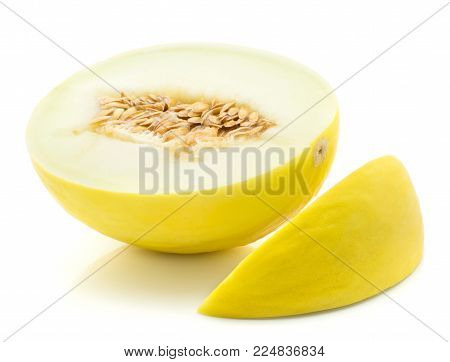 One yellow honeydew melon half with a slice isolated on white background