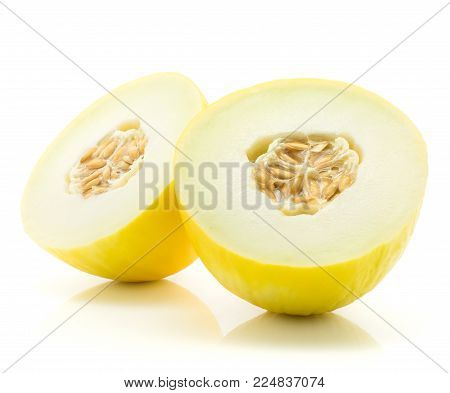 Yellow honeydew melon cut in half isolated on white background two halves with seeds