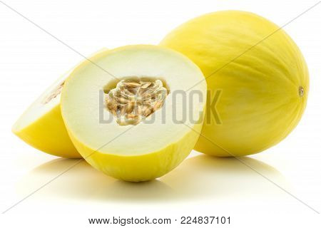 Yellow honeydew melon set, one cut in half and one whole, isolated on white background, two halves with seeds