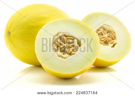Yellow honeydew melon and two section halves isolated on white background