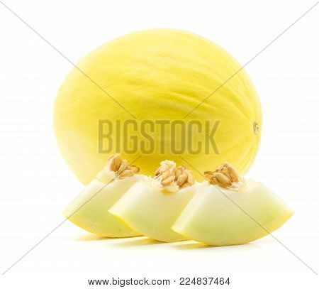 One yellow honeydew melon with three cut pieces isolated on white background