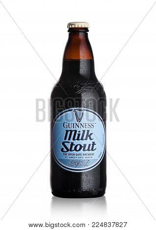 LONDON, UK - FEBRUARY 02, 2018: Cold bottle of Guinness Milk Stout dark beer on white background.