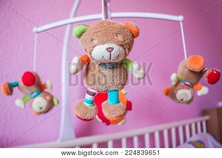Still Life of Baby Mobile with Blue Stuffed Animals. Selective focus.