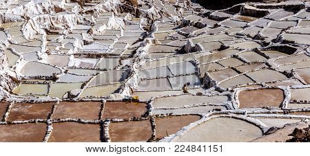 Since pre-Inca times, salt has been obtained in Maras by evaporating salty water from a local subterranean stream. The highly salty water emerges at a spring, a natural outlet of the underground stream. The flow is directed into an intricate system of tin