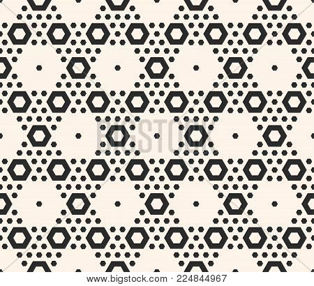 Vector geometric seamless pattern with big and small hexagons in hexagonal grid. Abstract modern background. Monochrome repeat texture, perforated surface. Design for decor, print, wrapping, embossing.