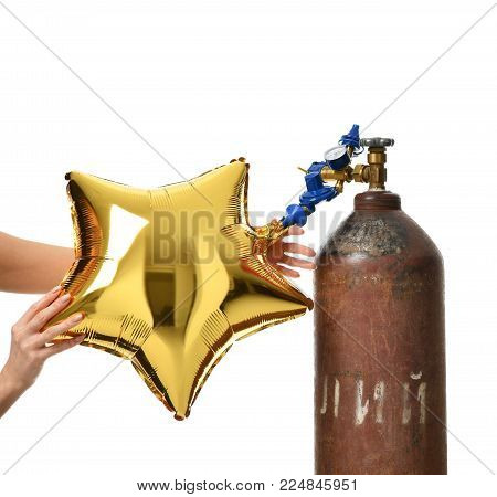 Hands inflate gold star balloon use Helium Tank with Economy Regulator Fill Valve for Latex Balloons isolated on white background