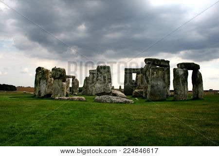 Cloudy day photograph of Stonehenge from a distract