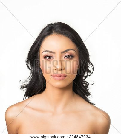 Beautiful woman's face bare natural skin