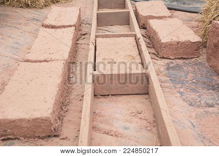 Hand made bricks with clay. Prepare mud for make bricks.