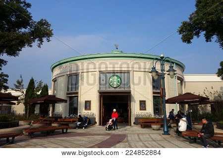 SHANGHAI, CHINA- JAN 22, 2018: Starbucks in Shanghai, China. Starbucks Corporation is an American coffee company and coffeehouse chain