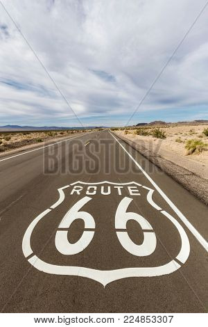Route 66 pavement sign near Amboy deep in the California Mojave Desert.