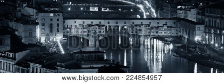 Ponte Vecchio over Arno River panorama in Florence Italy at night BW. poster