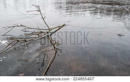 thin ice on the pond in the spring, the danger during the flood