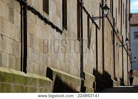 The high walls of the Benedictine Monastery (Mosteiro) of San Martino Pinario - Santiago de Compostela, Galicia, Spain
