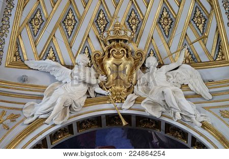 ROME, ITALY - SEPTEMBER 05: Statues of angels on the ceiling of Santissima Trinita degli Spagnoli Church in Rome, Italy on September 05, 2016.