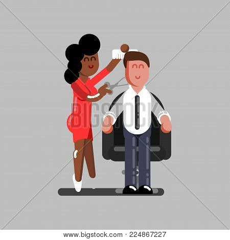 Hair dresser cuts clients hair. Professional barber making haircut to a client with scissors in barbershop.
