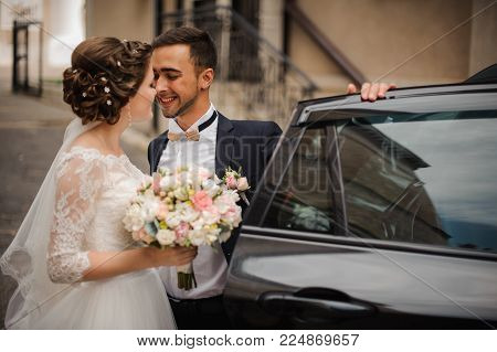 stylish groom and a gentle bride against the backdrop of a chic suburban hotel in anticipation of the first meeting