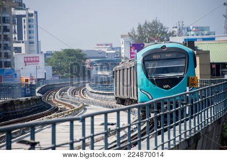 Kochi, India - January 11 2018: Kochi metro train towards Aluva approaching a station.
