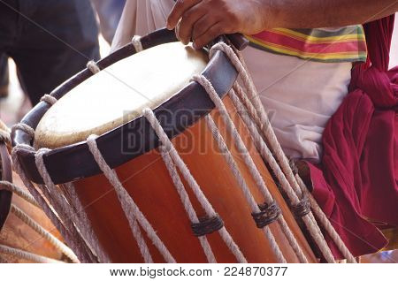 Indian Drummers In Kerala Playing Chenda Drums.