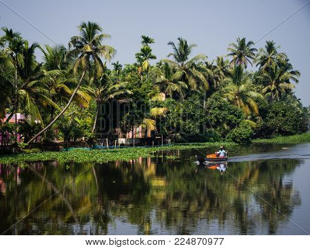 Alappuzha, India - January 09 2018 : Beautiful View Of A Fisherman On His Boat In Alappuzha, India