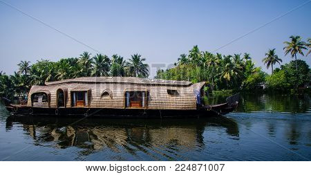 Alappuzha, India - january 09 2018 : Beautiful view of house boat moving through Vembanad lake in Kerala, India