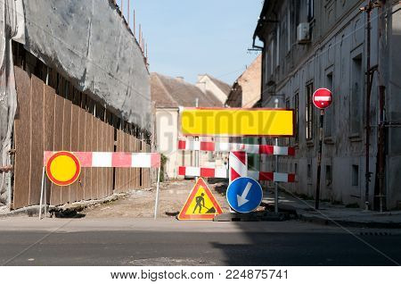 Work ahead street barricade barriers with caution traffic signs