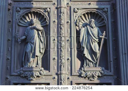 ST. PETERSBURG, RUSSIA - JANUARY 23, 2018: Bas-Relief Mosaic on Front Door Gate of St. Isaac's Cathedral. St. Petersburg Historical Landmark, Outdoor Detail of Orthodox Church Decoration Close Up.