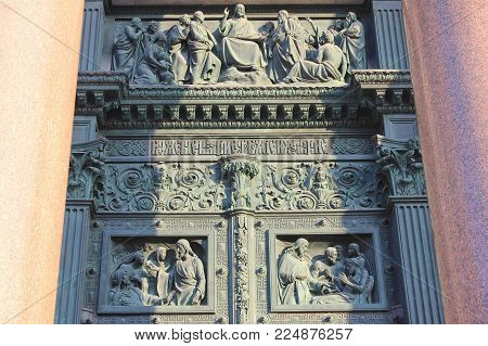 ST. PETERSBURG, RUSSIA - JANUARY 23, 2018: Saint Isaac's Cathedral Mosaic Bas-Relief Ornament on Bronze Front Door Gate. St. Petersburg Historic Landmark, Outdoor Detail of Orthodox Basilica Decor.
