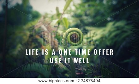 Motivational and inspirational quotes - Life is one time offer. Use it well. With blurred vintage styled background.