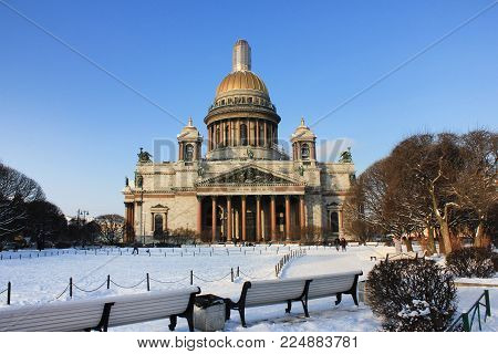 Saint Isaac's Cathedral Winter View in St. Petersburg, Russia. Russian Classical Architecture, Orthodox Church and Museum, Outdoor Scene. Park View with Snow on Cold Winter Season Evening.
