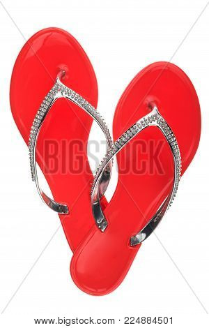 Luxury, decorated with rhinestone red beach flip flops, isolated on a white background