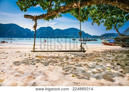 Swing at Viking I Beach on Phi Phi Islands.Thailand.  Phi Phi Islands are a popular tour destination from Phuket and Krabi.