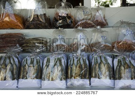 Dried seafood and Food product and gift souvenir at local shop for sale travelers people in Laem Phak Bia in Phetchaburi, Thailand
