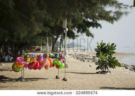 Toy and rubber ring for sale travelers people on the beach at Hat Chao Samran beach on November 18, 2017 in Phetchaburi, Thailand