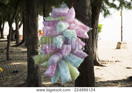 Colorful cotton candy or fairy floss or  candy floss in plastic bag hanging for sale travelers people at Hat Chao Samran beach in Phetchaburi, Thailand