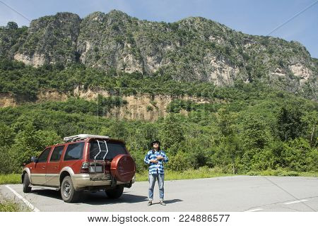 Thai Woman Posing With Car At Khao Nang Phanthurat Forest Park In National Parks And Marine Reserves