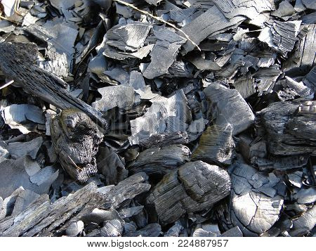Black charcoal background. Coal texture, view from above