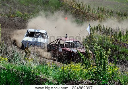 Race of the old wrecked cars. Rally on open air with dust