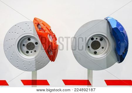 Brake Discs With Red And Blue Callipers From A Racing Car Isolated On White Background