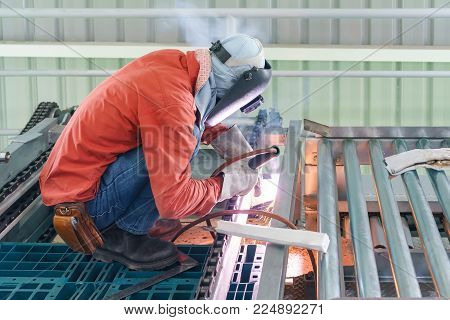 Male Worker Wearing Protective Clothing Welding The Steel Structure,craftsman, Erecting Technical St