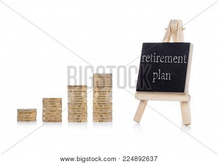 Retirement plan concept text on chalkboard with coins on white background