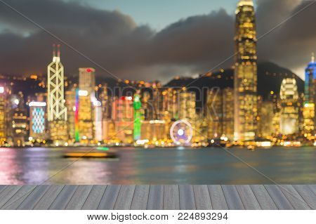 Opeing wooden floor, Night blurred bokeh Hong Kong downtown abstract background